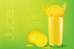 Falling piece of lemon in a glass of juice Royalty Free Stock Images