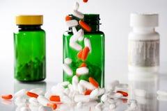 Falling pills Stock Image