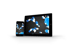 Falling pills on tablet and smartphone screens Royalty Free Stock Image