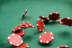 Falling Poker Chips. Red Poker Chips falling at green background Stock Photo