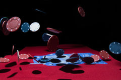 Falling poker chips. Abstract photo of poker chips falling Royalty Free Stock Photo