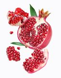 Falling pomegranate slices. Royalty Free Stock Image