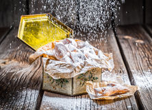 Falling powdered sugar on angel wings in box Stock Image