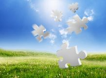 Falling puzzle Royalty Free Stock Photo