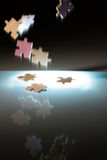 Falling puzzle pieces. Royalty Free Stock Photography