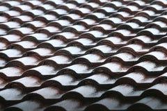 Falling Rain drop on brown brick roof Royalty Free Stock Photos