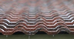 Falling Rain drop on brown brick roof Stock Photos