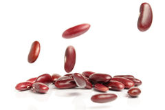 Falling red beans on white background Stock Image