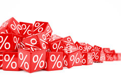 Falling red cubes with percent signs Stock Photography