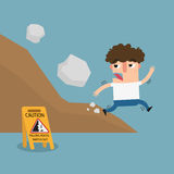 Falling rock caution sign Royalty Free Stock Photo