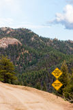 Falling Rock danger sign with mountain view Royalty Free Stock Photo