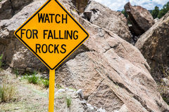 Falling Rocks Danger Warning Road Sign Stock Photo