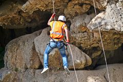 Falling by rope adventurer Stock Photography
