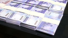 Falling 100s on stacks of New Taiwan Dollars stock video footage