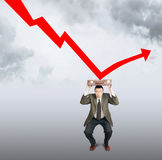 Falling of sales hits the businessman Stock Images