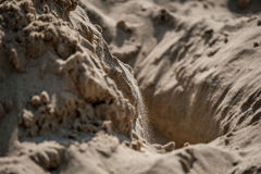 Falling Sand into Hole Royalty Free Stock Photography