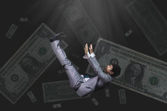 Falling and screaming businessman in formal wear bank note on bl Stock Photo