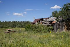 Falling shed and junk car Royalty Free Stock Photos