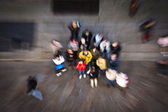 Falling from the sky. Intentionally motion blurred abstract image of a zoomed in group of people standing on a gray background. The image is related to any Stock Photos