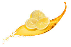 Falling slices of lemon with juice splash isolated Stock Images