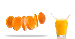 Falling slices of orange in air isolated on white Royalty Free Stock Photos