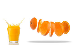 Falling slices of orange in air and juice splash Royalty Free Stock Image