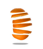 Falling slices of orange in air  on white Stock Image