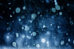 Falling Snow. Abstract of blurred snow falling at night Stock Images