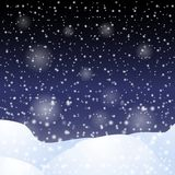 Falling snow against the dark night sky. Stock Photography