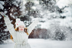 Falling snow around the child. Royalty Free Stock Photography