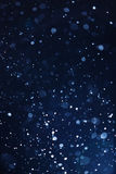 Falling snow background Stock Images