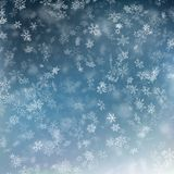 Falling snow on a blue background. Abstract white snowflake and sparkles background. EPS 10 vector illustration