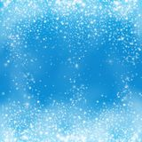 Falling snow on the blue background. Snowflake on winter blue sky vector.  Stock Image