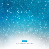 Falling snow on the blue background Stock Photos