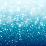 Falling snow on a blue background. Vector illustration 10 EPS. Abstract white glitter snowflake background. Vector magic Stock Images