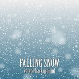 Falling snow. On the blue background - vector image Stock Photos