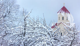 Falling snow. From the church roof Royalty Free Stock Photos