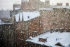 falling snow with the city on background royalty free stock photo