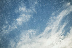 Falling snow with dramatic sky background. Royalty Free Stock Photography