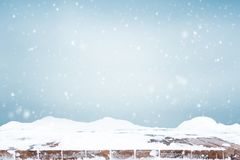 Falling snow over wooden deck royalty free stock photography