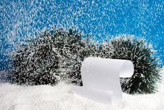 Falling snow on a scroll. Royalty Free Stock Photos
