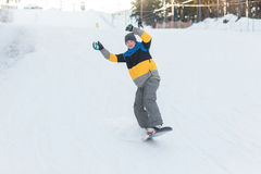 Falling snowboarder downhill Royalty Free Stock Photography
