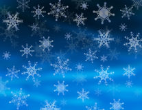 Falling snowflakes. In different shapes on night blue background Stock Photo