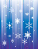 Falling snowflakes on a blue background Stock Photo