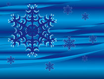 Falling snowflakes on a blue background Royalty Free Stock Images
