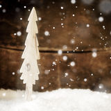 Falling snowflakes on a Christmas tree Stock Photo