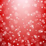 Falling snowflakes on red background Royalty Free Stock Images