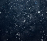 Falling snowflakes and stars Royalty Free Stock Photos
