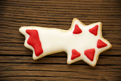 Falling Star Cookie on Wood II Royalty Free Stock Photo