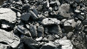 Falling stones of coal. Miner`s dust. Stone ore for fuel.
